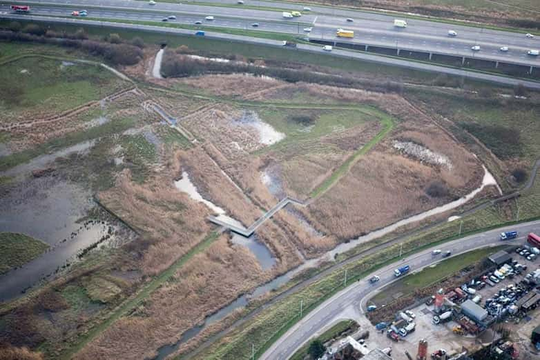 Aerial view of restored wetlands, a mix of wet grassland, reedbeds and open water, with the new public access paths