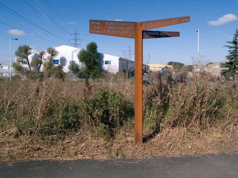 New path signage fabricated from weathering steel with cutout lettering