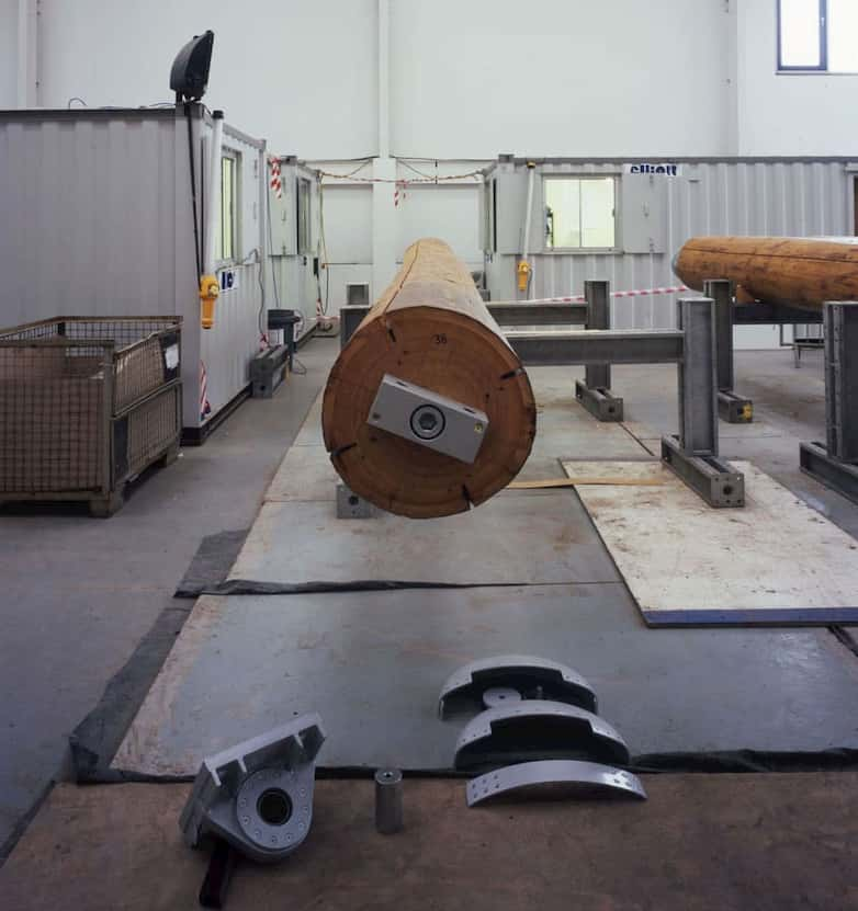 Site assembly of timber columns | pin joints with spherical bearings are used at base and head of each column.